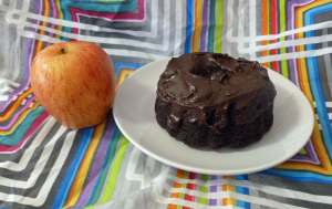 Chocolate Mini Bundt Cake with Chocolate Cinnamon Frosting with an apple for size comparison