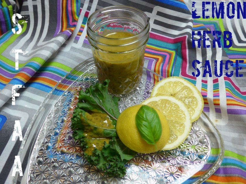 lemon herb sauce drizzled over a kale leaf propped up on lemon slices and basil