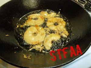 Apples being deep fried in oil