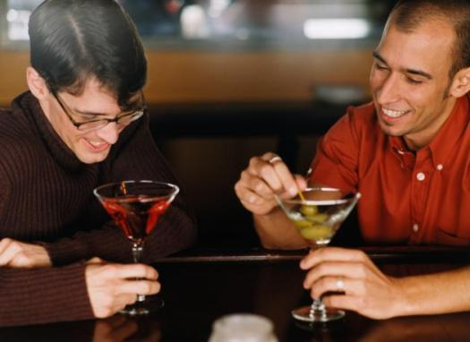 gay couple drinking cocktails