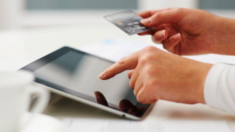man buying privately through online laptop