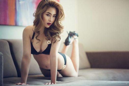 Asian Woman on Lounge