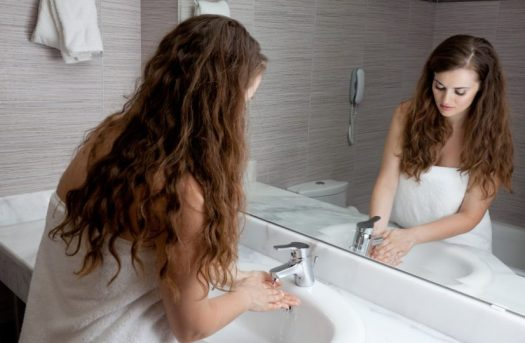 Woman Cleaning in Bathroom