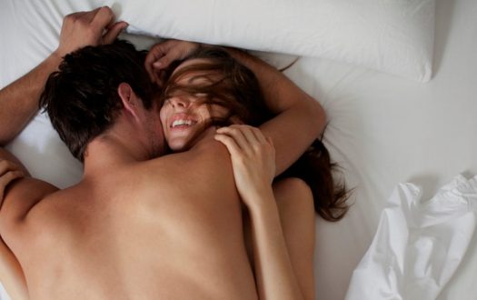 Couple Being Happy In Bed Photo