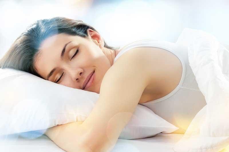 Woman Sleeping in Bed Photo