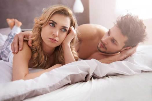 Man Comforting Women in Bed Photo