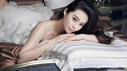 Singaporean Woman on Bed Photo