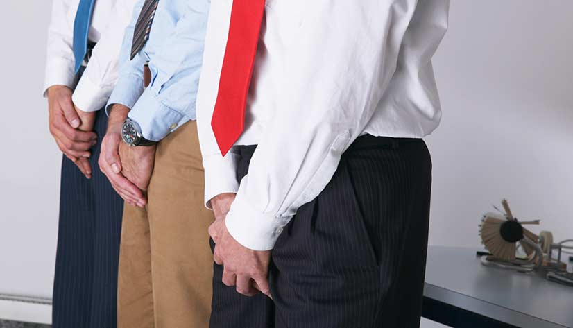 3 Men Covering Their Genitals In An Office