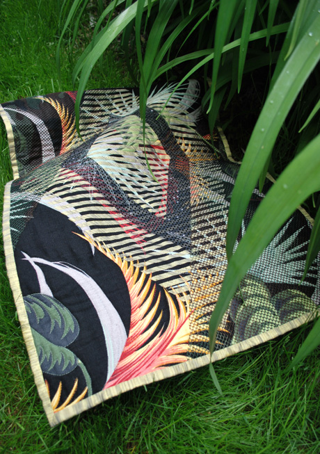 quilt and grasses