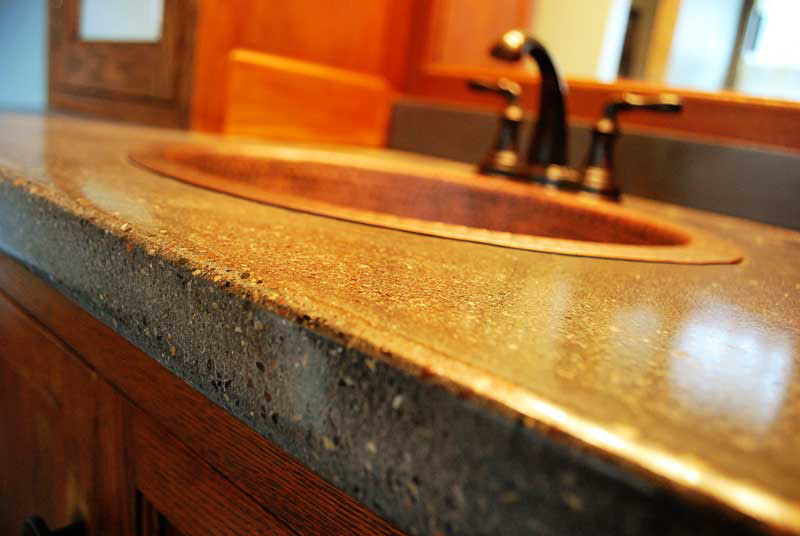 copper sink with concrete countertop