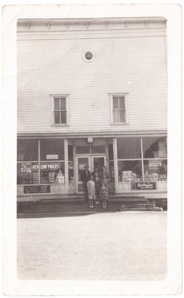 family in front of old general store