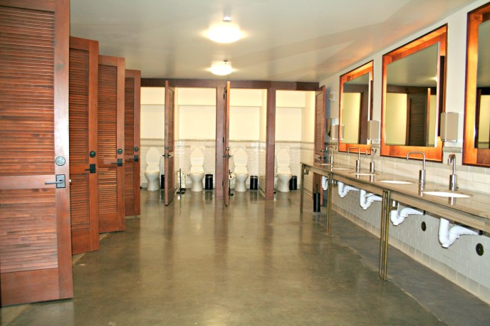polished cement flooring cherry wood louver doors