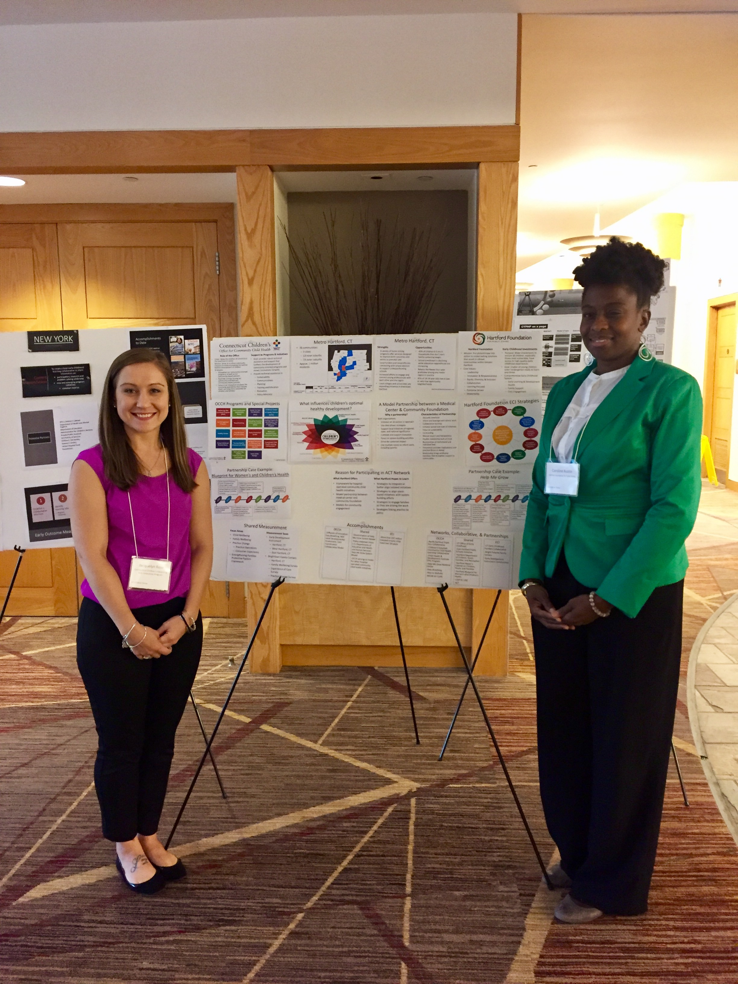 Jacquelyn Rose, MPH and Caroline Austin with All Children Thrive poster.