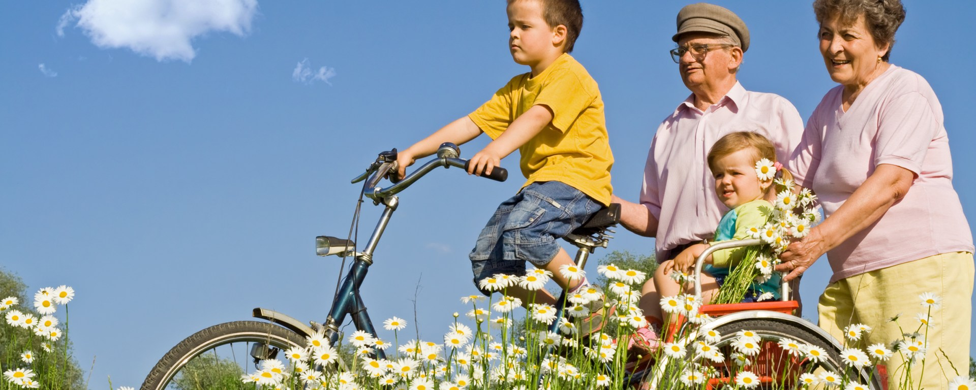 Grandparents with Grandchildren on bicycles.