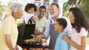 A family barbequing outside.