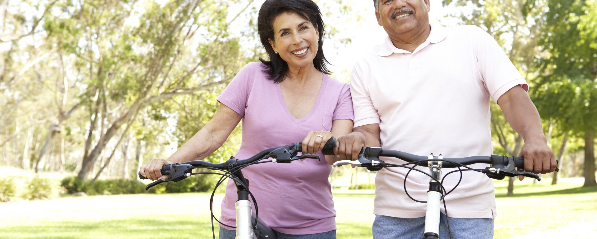 A couple riding bicycles.