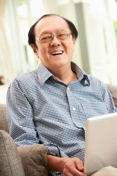 Smiling man on computer