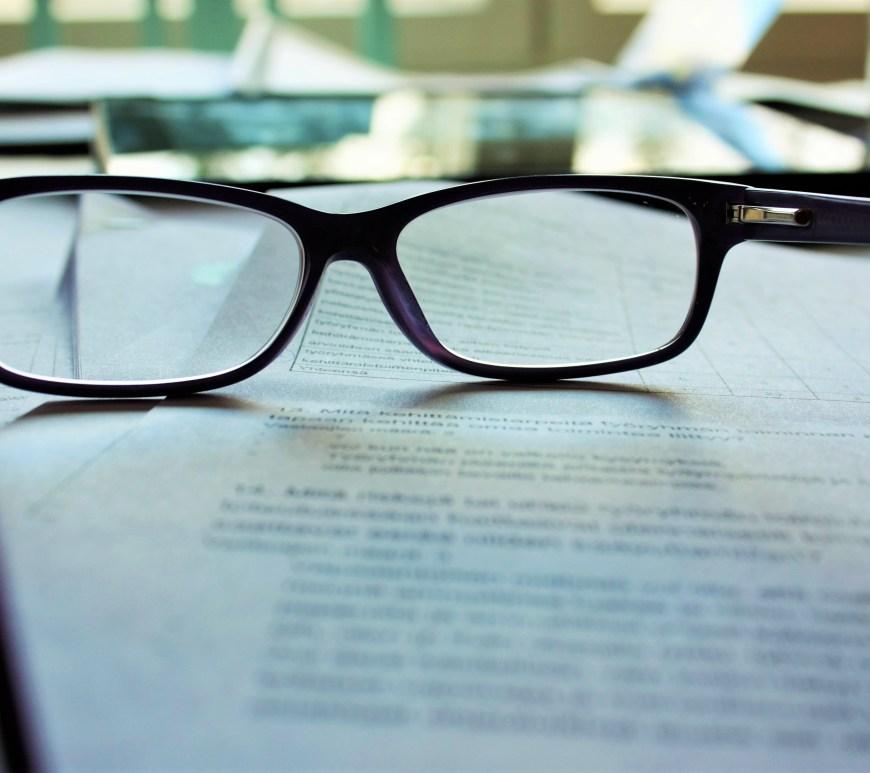 Eyeglasses sitting on paper.