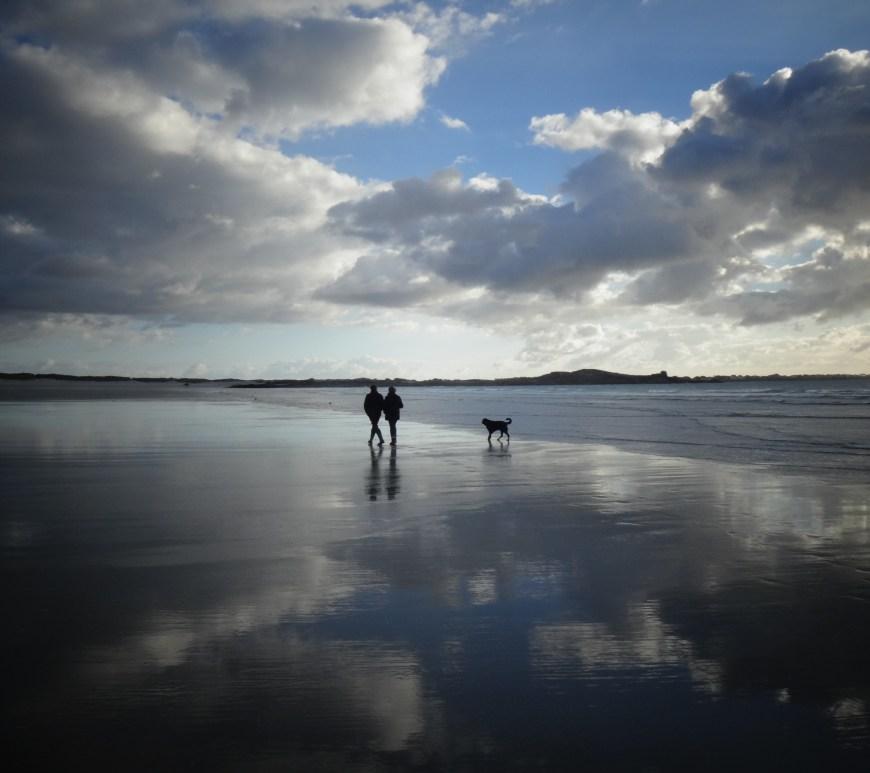 People walking by the shoreline