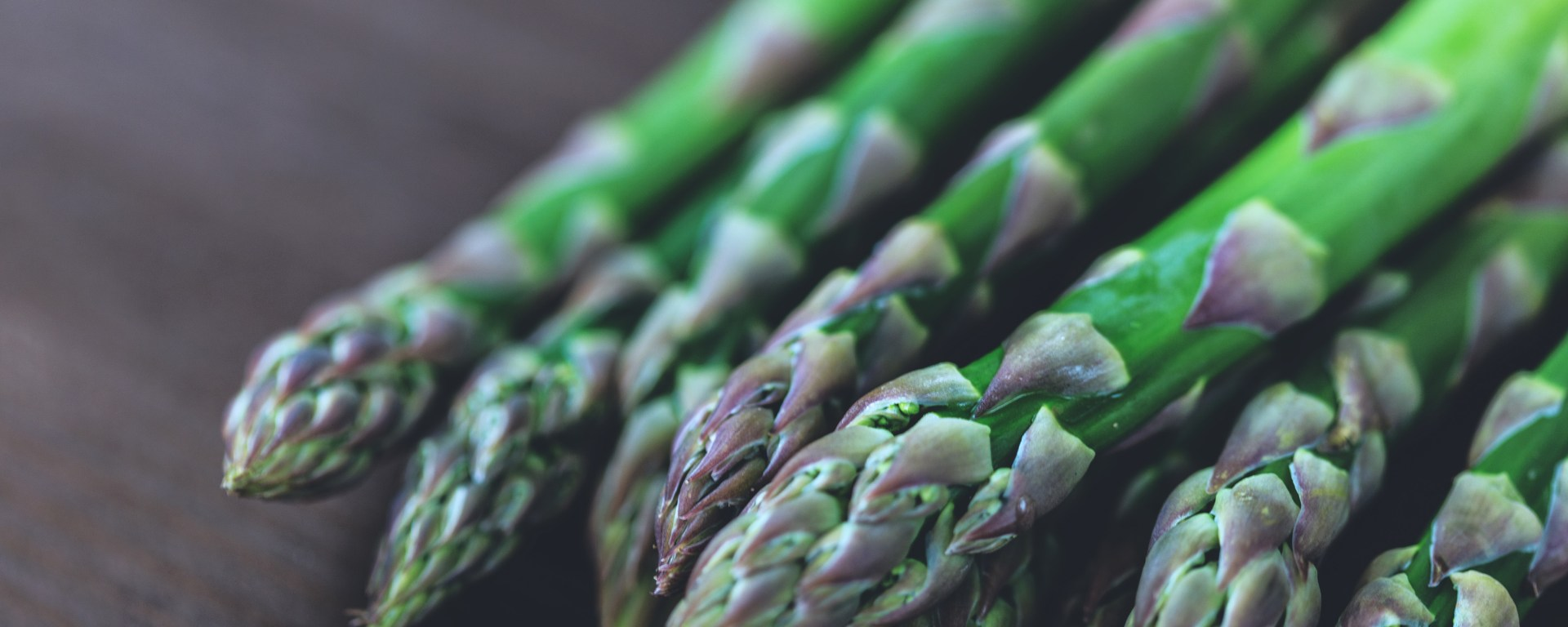 Fresh green asparagus on table