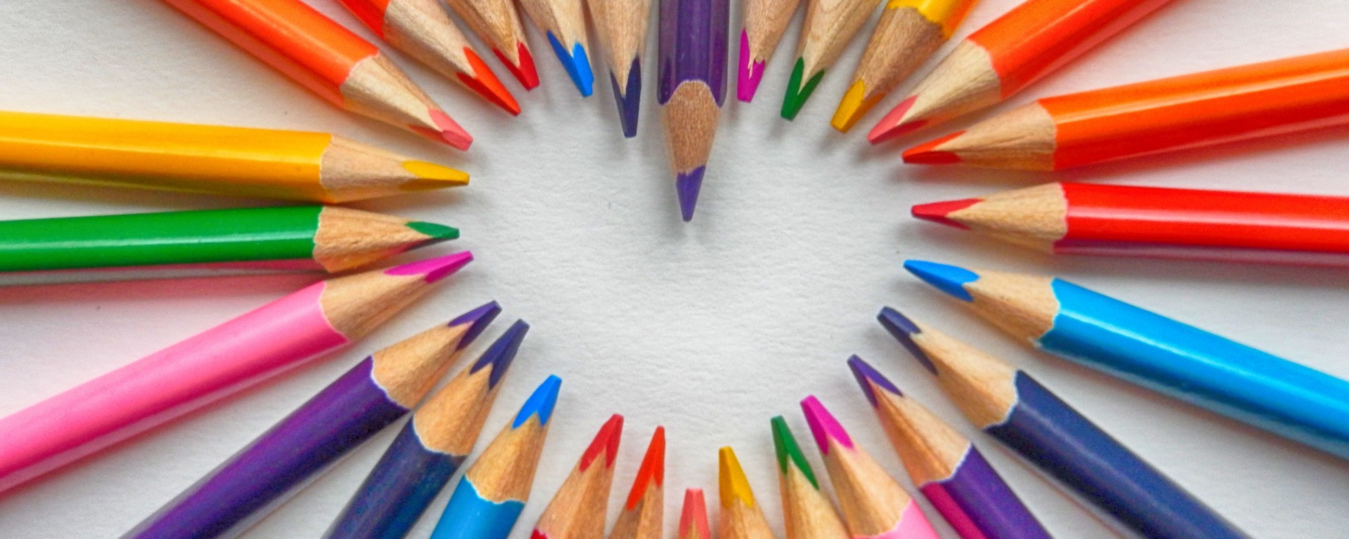 coloring pencils forming a heart