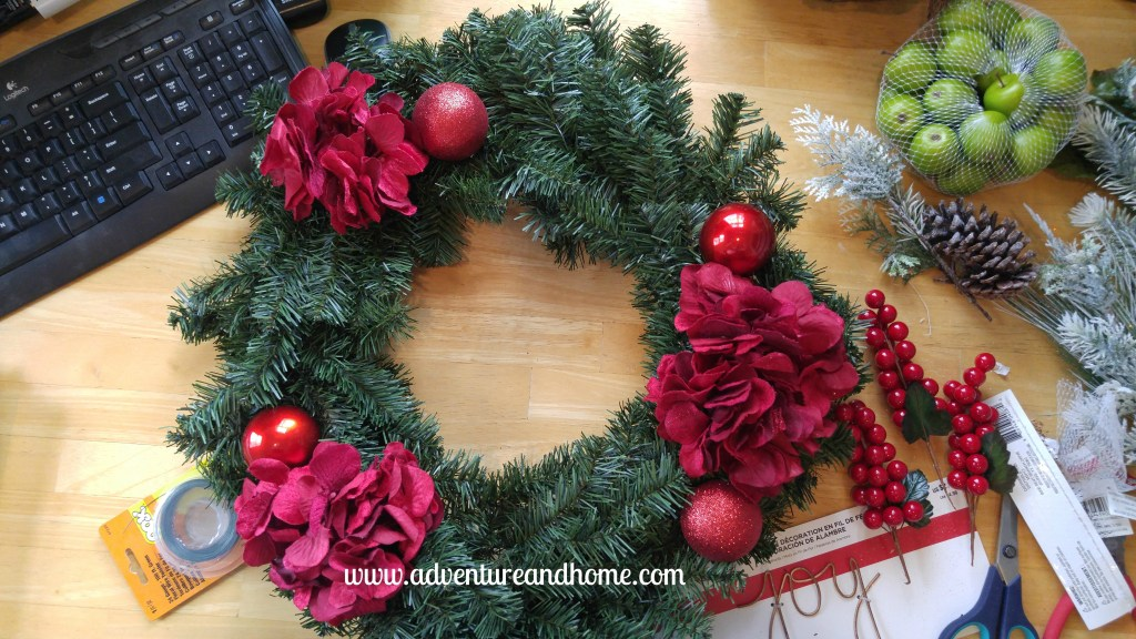 Inviting door decor for less than $25 to make! This wreath project takes less than an hour and will make your door look stunning for the holiday season!