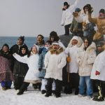 Alaskan Eskimos Stand In Front of Fresh Catch