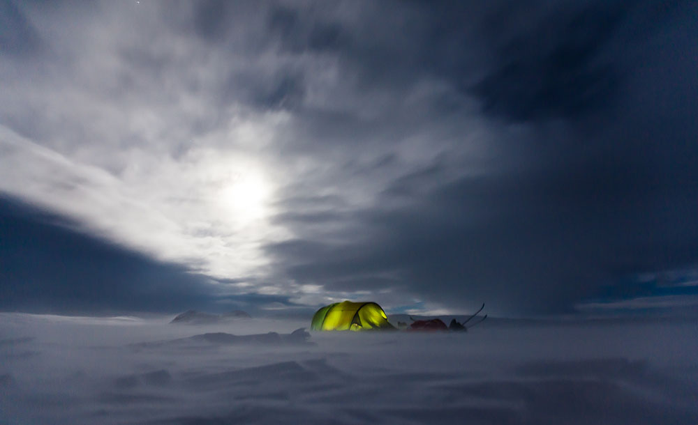 Snowy arctic with a tent in view