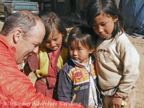 Phil shows these kids their photo. The boy on the left is a Tulku, a reincarnate Lama, still living with his family in the Phobjika Valley.