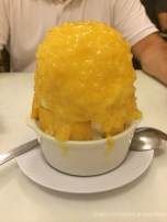 Dessert from a hawker stall! it's shaved ice with a mango syrup/sauce. So good.