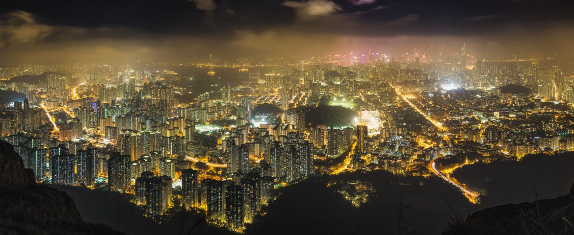 Nightscape of the Kowloon City viewed from the Lion Rock. This is one of the best Hong Kong skyline photography locations