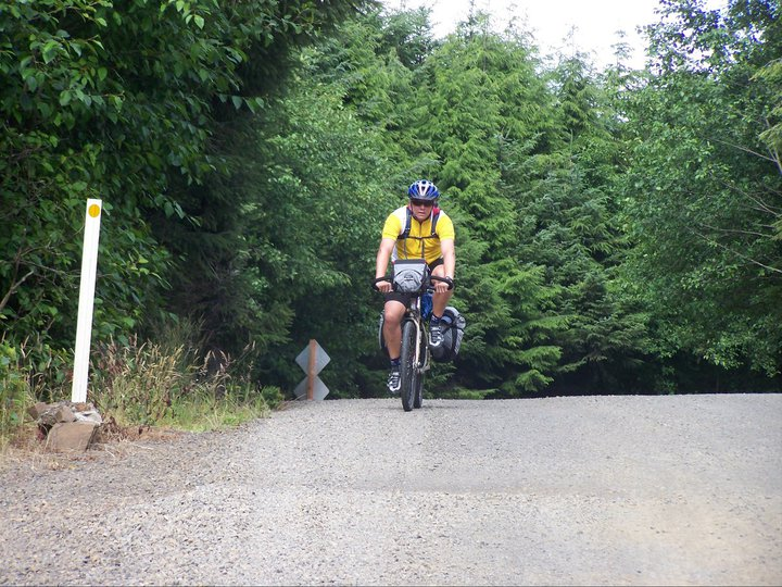 The author atop the first climb of his first long-distance bike tour, biking across America.