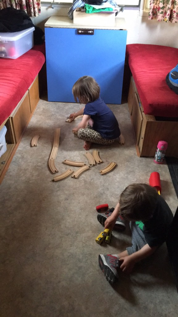 Jane and Wilson playing with their train set.