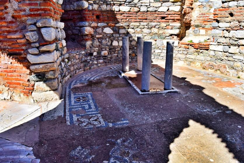 Original mosaic flooring around the font in the Church