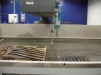 """Finally, the waterjet cutter - which sprays water and sand at such high speeds it can cut metal. Even very thick metal (up to 6"""" thick.)"""