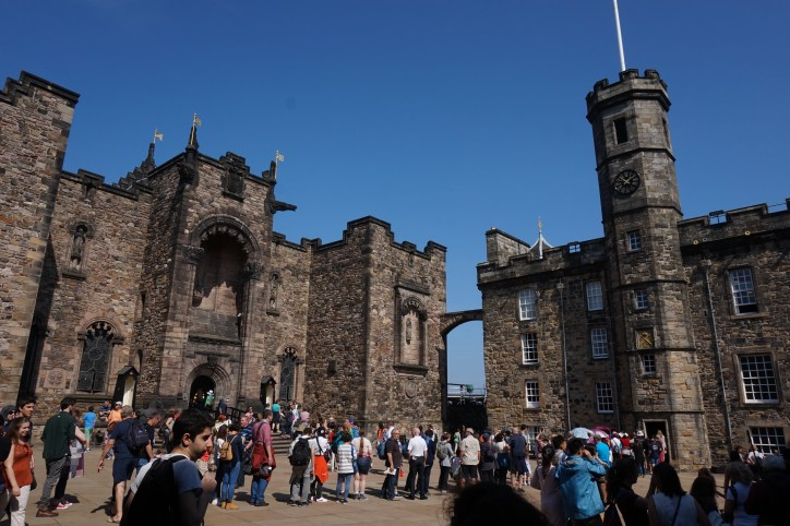 Within Edinburgh Castle walls, looking at the various stone buildings.