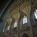 The ornate ceiling and high windows of the cathedral in Winchester, England.