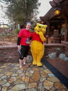 Posing with Pooh Bear in Fantasyland