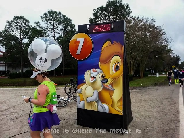 One of the Balloon Ladies checks her time at Mile Marker 7