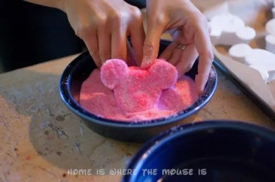 coating the mickey mouse marshmallows with sugar