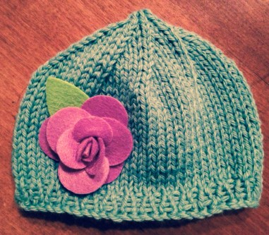 Light blue hat with a beautiful purple flower