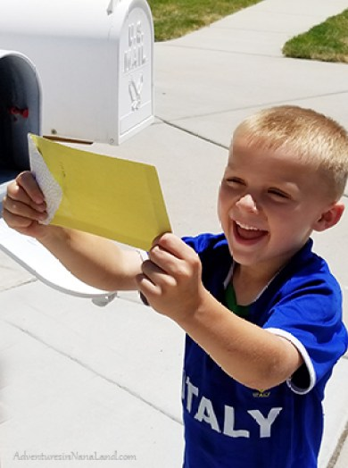 Grandchild getting mail from penpal grandparent, happy child getting mail, getting mail makes kids happy