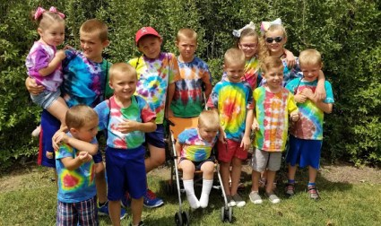 group of grandkids with matching tie dye shirts - Adventures in NanaLand - Becoming a grandparent