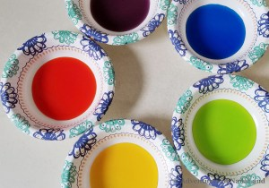 5 paper bowls filled with colored water - orange, yellow, green, blue, purple - Adventures in NanaLand