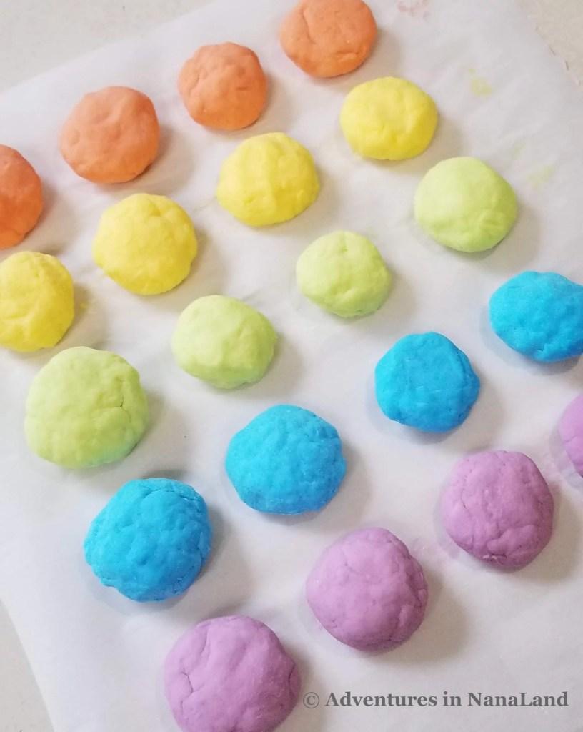 Magic rainbow rocks in orange, yellow, lime green, blue, and purple - Adventures in NanaLand