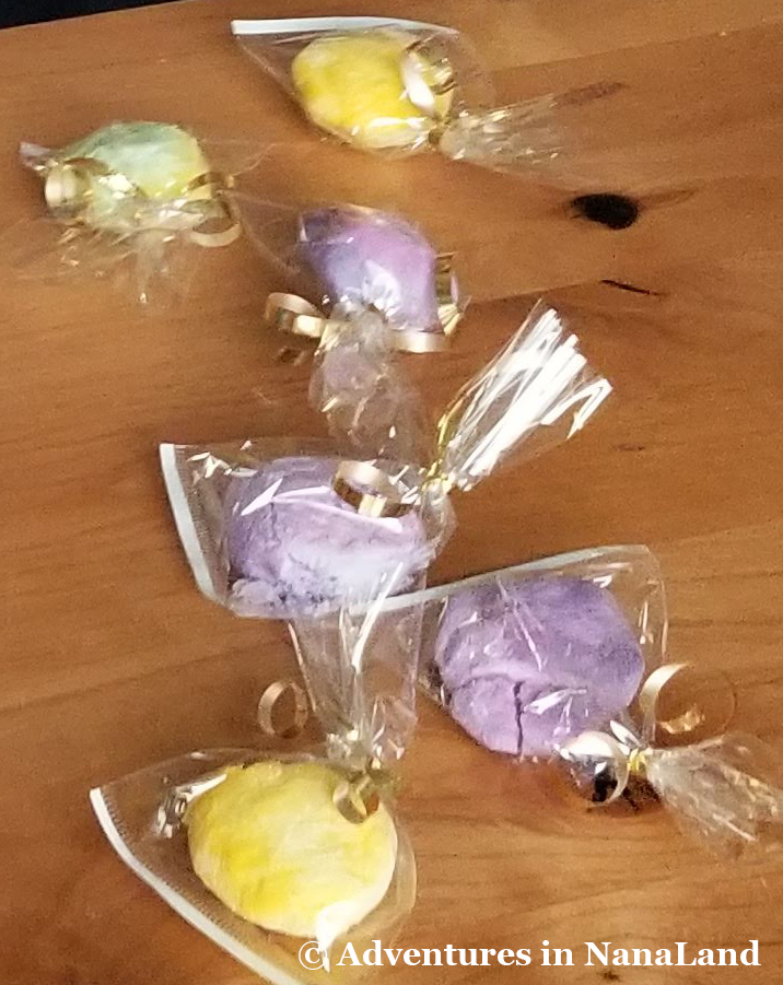 Magic Rainbow Rocks in plastic bags tied with gold bow - St. Patrick's Day activities - Adventures in NanaLand