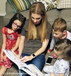 Kids reading book with mother - Fun games to play over Skype - Adventures in NanaLand