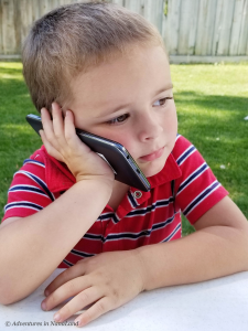 Toddler on cell phone - Living far away from grandchildren - Adventures in NanaLand
