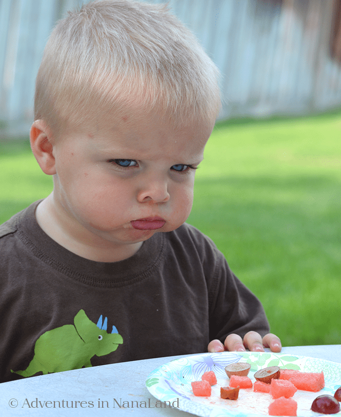 Child eating with a sad face - Kid friendly meals - Adventures in NanaLand