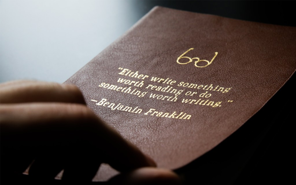 Quote by Benjamin Franklin on the front of a brown book - Writing a life story - Adventures in NanaLand